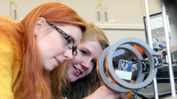 Two students working in a physics lab
