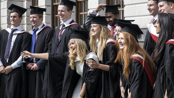 Students posing for group photos at graduation