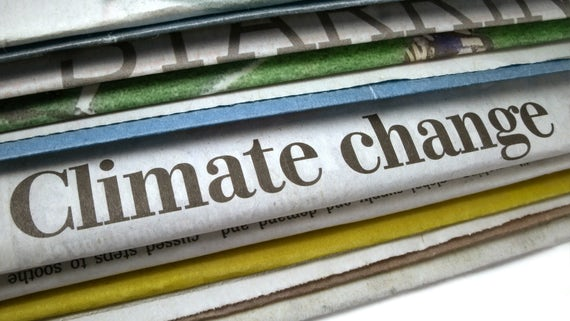 Newspaper headline on Climate change