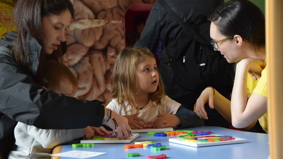 Children playing with puzzle at Brain Games 2017