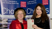 Fatma Pinar John receiving her Foundation certificate to Pathway to Business Management from Professor Elizabeth Treasure