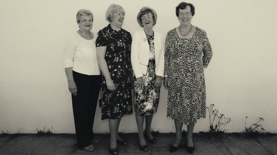 Four Women's Institute members laughing