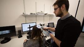 A researcher applies brain stimulation to a participants head