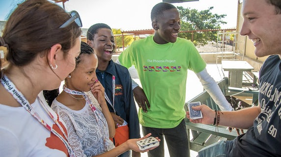 Namibian students laughing at a card trick