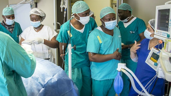Phoenix Project's Najia Hasan teaching anaesthetics to Namibian medical officers in Rundu's operating theatre.