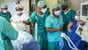 View image of Phoenix Project's Najia Hasan teaching anaesthetics to Namibian medical officers in Rundu's operating theatre.