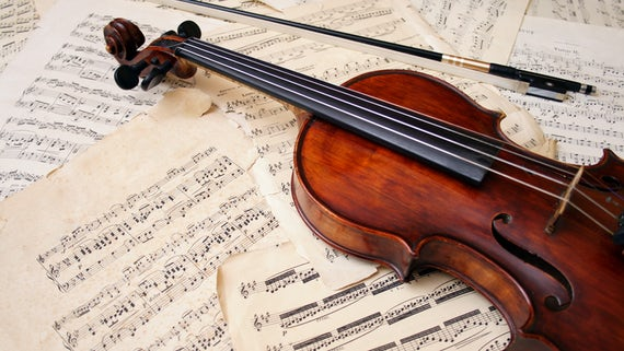 Violin on top of music scores
