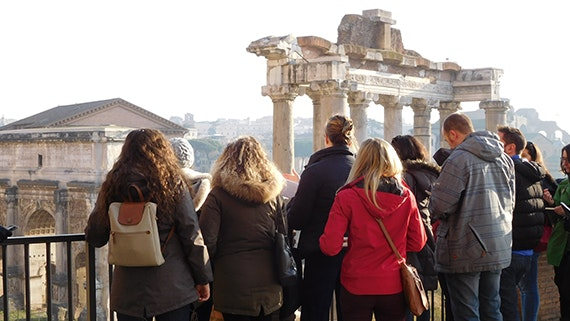 Dr Oriel Prizeman introducing students to the Roman Forum