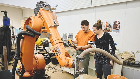 Students using a robot arm