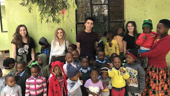 Four chemistry students volunteered their time in Arusha