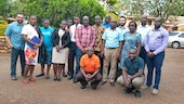 Dr Marco Pomati and Dr Shailen Nandy with researchers in Uganda