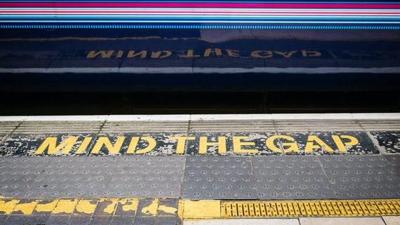 Mind the gap train station sign