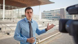Student speaking to camera outside Welsh Assembly