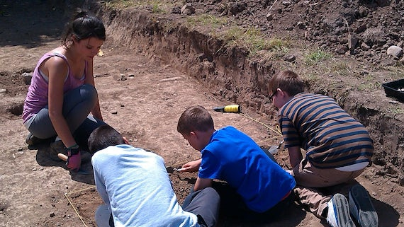Local school pupils excavate at Caerau hill fort in southeast Wales.