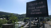 COVID-19 signage in North Wales tourism spot