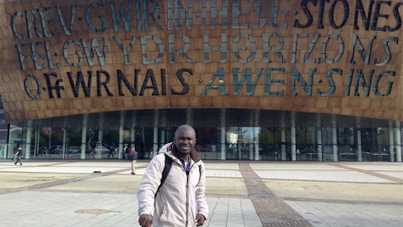 Man standing in front of the Wales Millennium Centre.