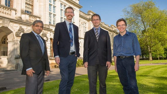 Members of the Gravitational Physics Group standing outside Main Building, Cardiff University