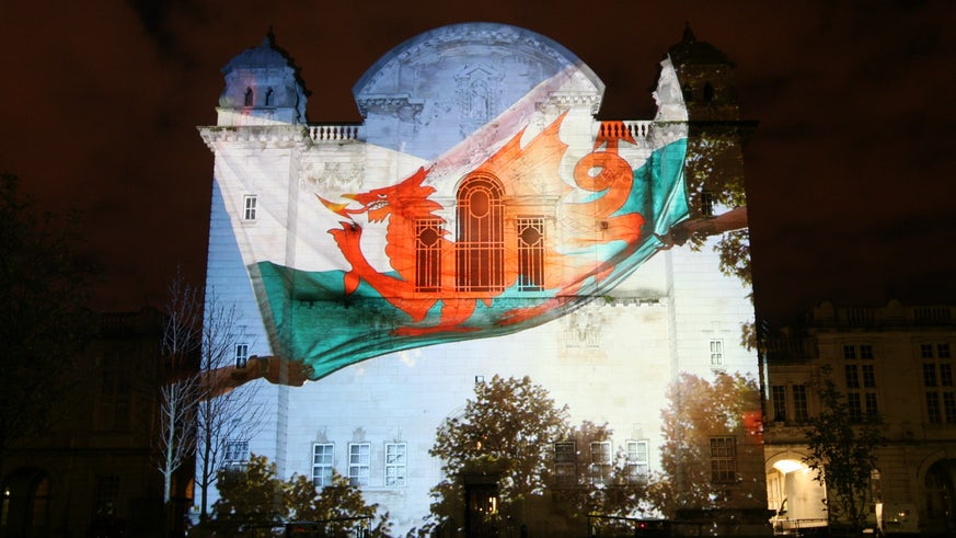 Welsh dragon projected on Main Building