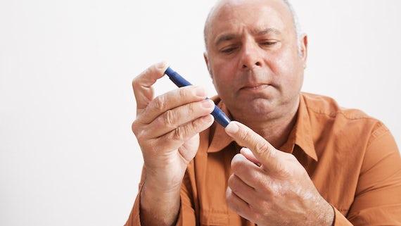 Man using EpiPen