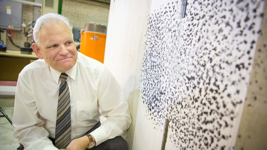 Professor Robert Lark with self-healing concrete