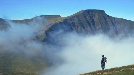 Walker in the Brecon Beacons National Park, Pen-y-Fan, from Cribyn