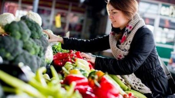 Girl shopping in a farmers' market