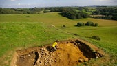 Woman digging in an archaeological trench at Ham Hill