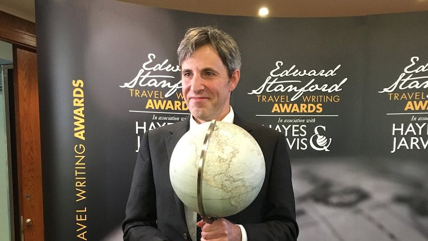 Tristan Hughes collecting his award at the special ceremony in London.