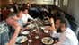 View image of People talk over dinner