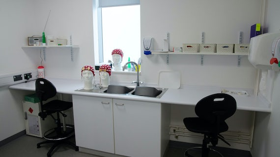 EEG preparation room with electrodes, skull caps, sinks, cupboards and chairs