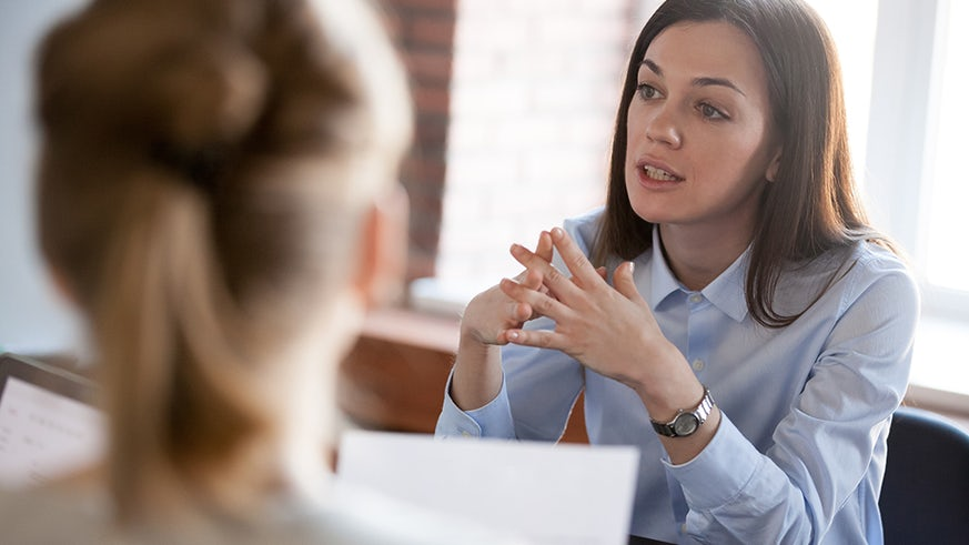 Female interviewing a potential candidate