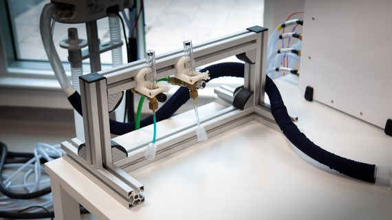 a custom-built metal frame holds two gas flow meters for mri studies