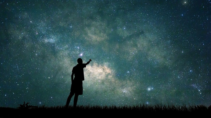 Person looking at night sky