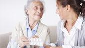 pharmacist with elderly patient