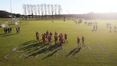 Students training on the University sports fields