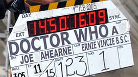 Clapboard with 'Doctor Who: Director - Joe Ahearne, Camera - Ernie Vincze' printed on it