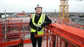 Tom Hyett stood on top of the Abacws building