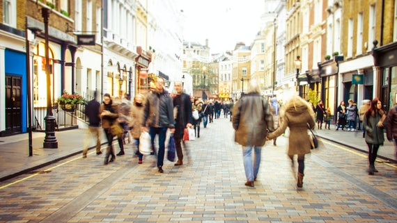Busy shopping street - stock photo. Motion blurred shoppers on busy high street