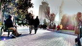 People walk and talk at typical city square in China