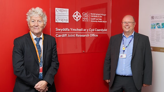 (L-R) Professor Ian Weeks, Pro Vice-Chancellor for the College of Biomedical and Life Sciences at Cardiff University, and Len Richards, Chief Executive of Cardiff and Vale University Health Board