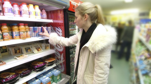 A student shopping in a mini mart