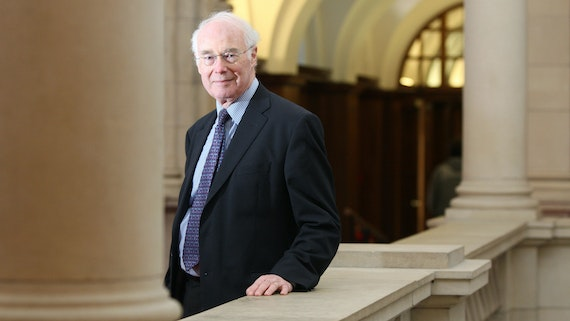 Sir Martin Evans standing on the first floor of Main Building.