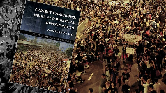 A book cover showing a protest