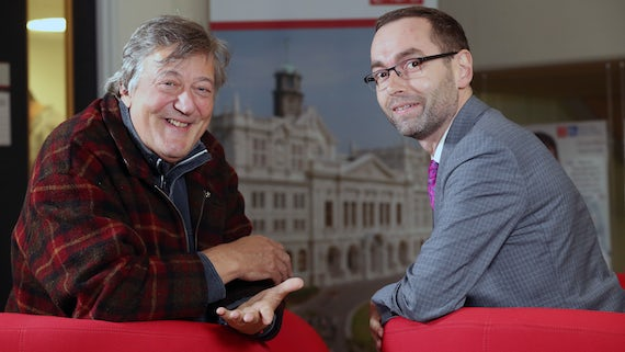 Photograph of Stephen Fry with Ben Lewis, Director of Student Support and Wellbeing