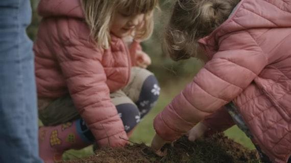 Children planting at the Grange Pavilion