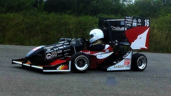 A student driving the Formula Student car