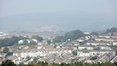 A view across the roofs of a Valleys town through the haze
