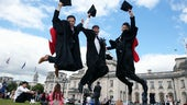 graduates jumping in celebration