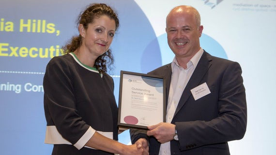 Image of Dr Neil Harris receiving a certificate from RTPI Chief Executive, Victoria Hills