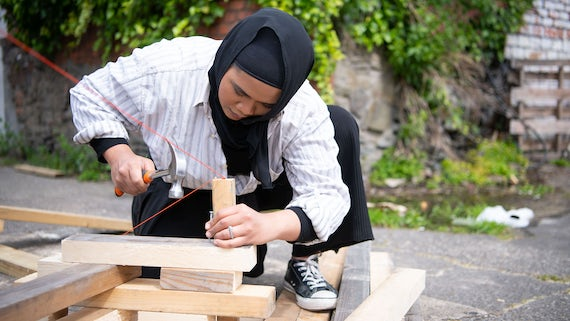 Student hammering pieces of wood together